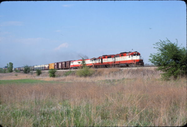 GP35s 711, 715 and U25B 820 somewhere in Kansas in May 1980