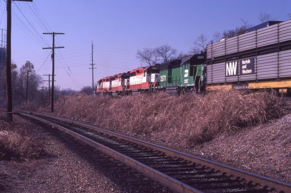GP40-2s 3044, 3049 and 3052 Westbound at Southwest Junction in St. Louis, Missouri in November 1981