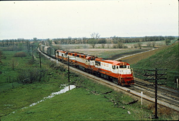 U25B 815, GP38-2s 456 and 432, and U30B 851 at Olathe, Kansas in April 1979 (Trackside Slides)