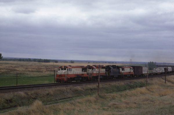U25B 826, unidentified, GP35 712, unidentified at Lawrence, Kansas in June 1967