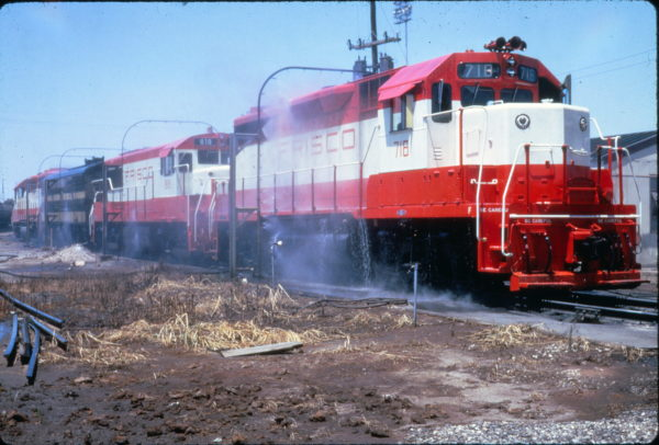 GP35 718 and U25B 818 at the washrack at Memphis, Tennessee on July 31, 1966 (Al Chione)