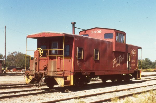 Caboose 1409 at Neodesha, Kansas on September 1, 1979