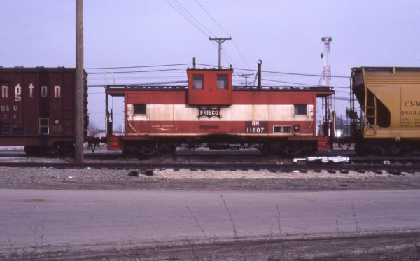 Caboose 11607 (Frisco 1279) at Aurora, Illinois on March 15, 1983 (D.R. Halfield)