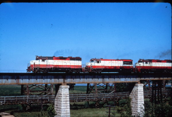 GP35 717, U25B 808 and GP38-2 692 crossing the Mississippi at Memphis, Tennessee on August 8, 1976 (Al Chione)