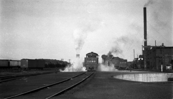2-8-0 1280 and 4-8-2 4306 at the Monett, Missouri Engine Terminal in 1939