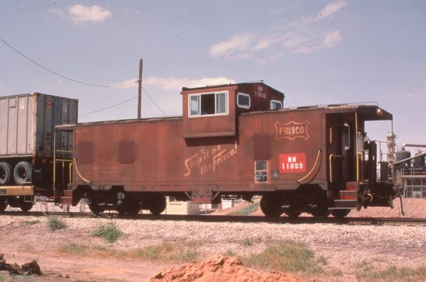 Caboose 11693 (Frisco 1719) at Enid, Oklahoma on June 28, 1984 (Marshall Higgins)
