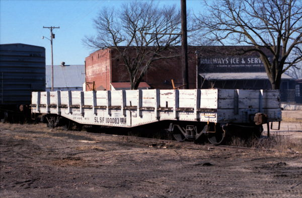 MOW Flatcar 100083 at Aurora, Missouri (date unknown) (Bob Dye)