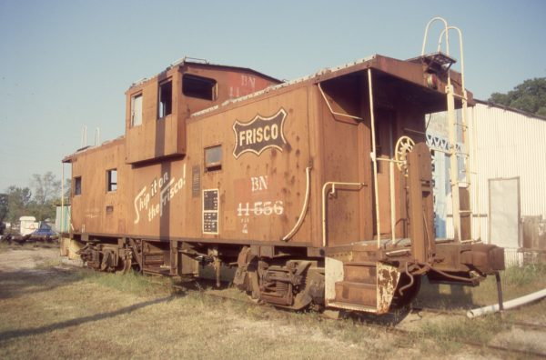 Caboose 11556 (Frisco 1228) at Okmulgee, Oklahoma on October 16, 1998 (R.R. Taylor)
