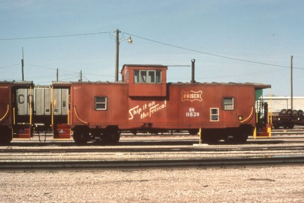 Caboose 11639 (Frisco 1409) at Enid, Oklahoma on April 10, 1983 (Marshall Higgins)