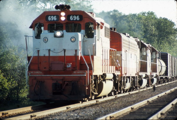 GP38-2 696 leads a train in June 1978 (location unknown)