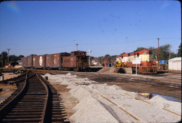 GP7s 532, 583 and Caboose 1126 at Cuba, Missouri on September 31, 1972