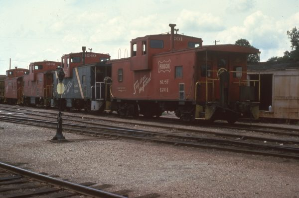 Cabooses 1170, 1266, 1240 and 1201 at Hugo, Oklahoma in June 1976