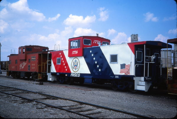 Cabooses 1776 and 1225 at Enid, Oklahoma on September 9, 1975