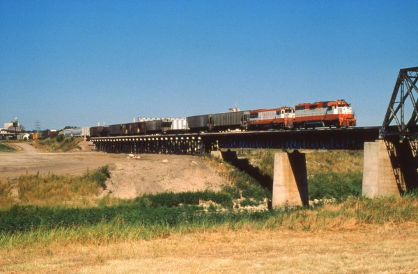 GP38-2 681 and U25B 813 at Fort Worth, Texas on July 30, 1979 on Train #38