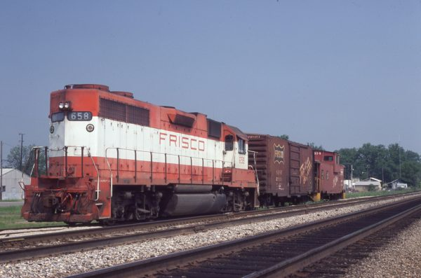 GP38AC 658, Boxcar 27171 and Caboose 1414 at Marion, Arkansas in May 1980