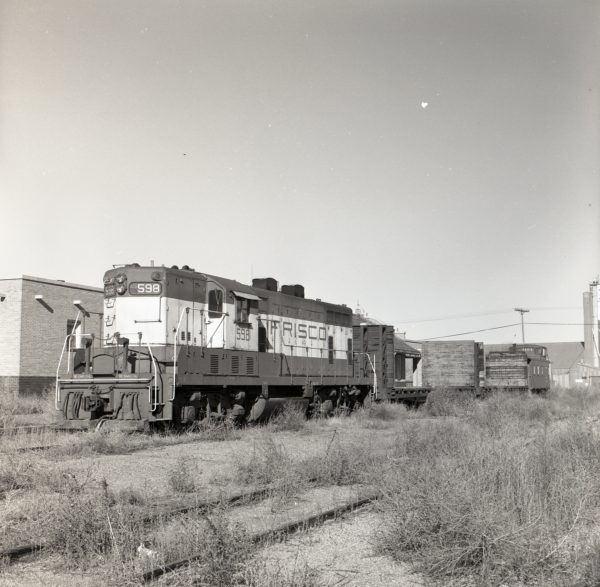 GP7 598 and Caboose 1104 at Floydada, Texas on December 2, 1976