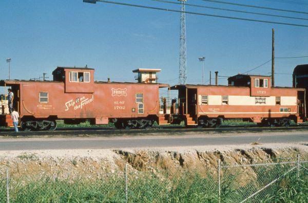 Cabooses 1702 and 1723 at Tulsa, Oklahoma on July 4, 1979
