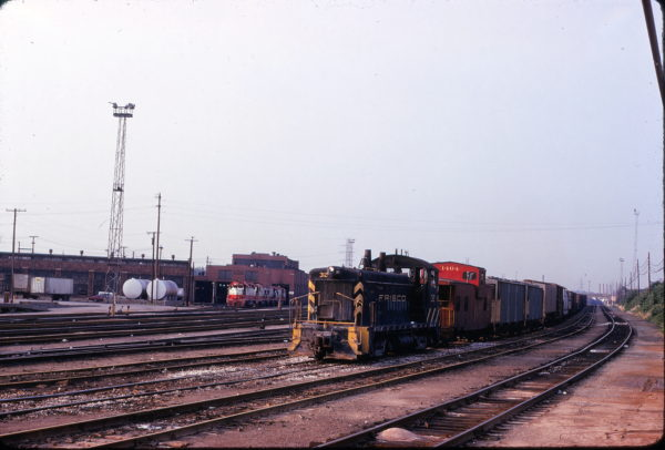 SW9 312 and Caboose 1404 at St. Louis, Missouri on June 26, 1975