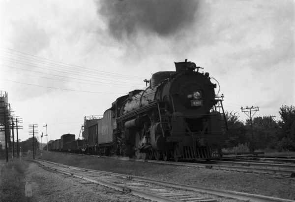 4-8-2 4303 on Train #38 (3rd Section) at Southeastern Junction in 1943