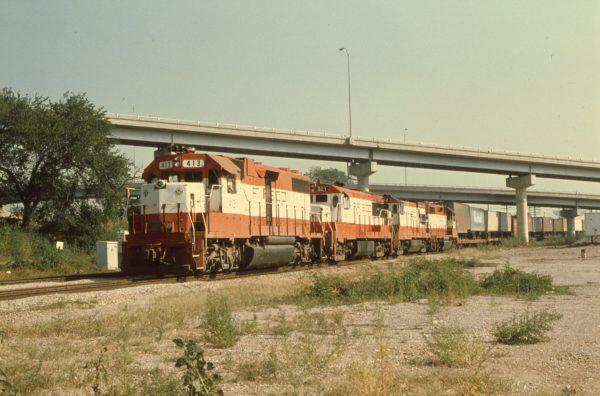 GP38-2 413, U25B 821, U30B 842 and GP38AC 645 at Tulsa, Oklahoma on August 18, 1979