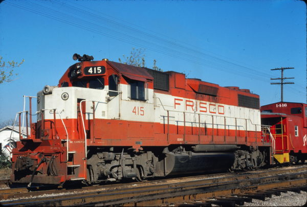 GP38-2 415 and Caboose 1416 at Hayti, Missouri on November 11, 1979 (Hugh Blaney)