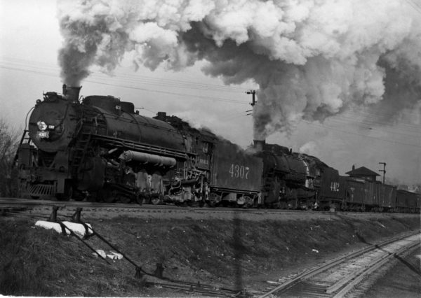 4-8-2s 4307 and 4412 Northbound with Train #37 at Southeastern Junction, St. Louis, Missouri in 1942 (William K. Barham)