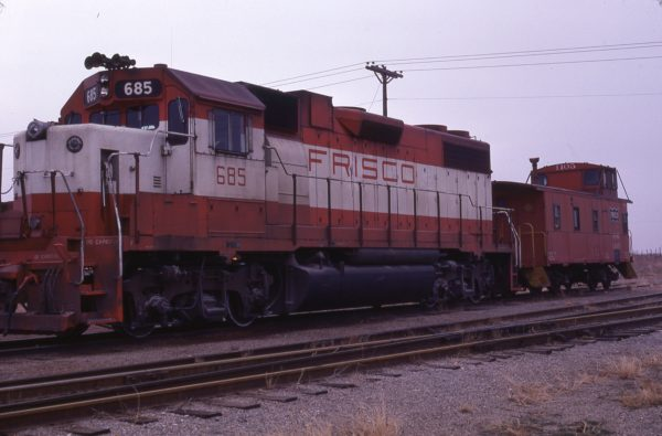 GP38-2 685 and Caboose 1105 (location unknown) in January 1978
