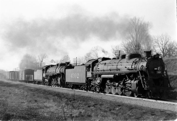 4-8-2s 4302 and 4417 Eastbound at Kirkwood, Missouri in 1942