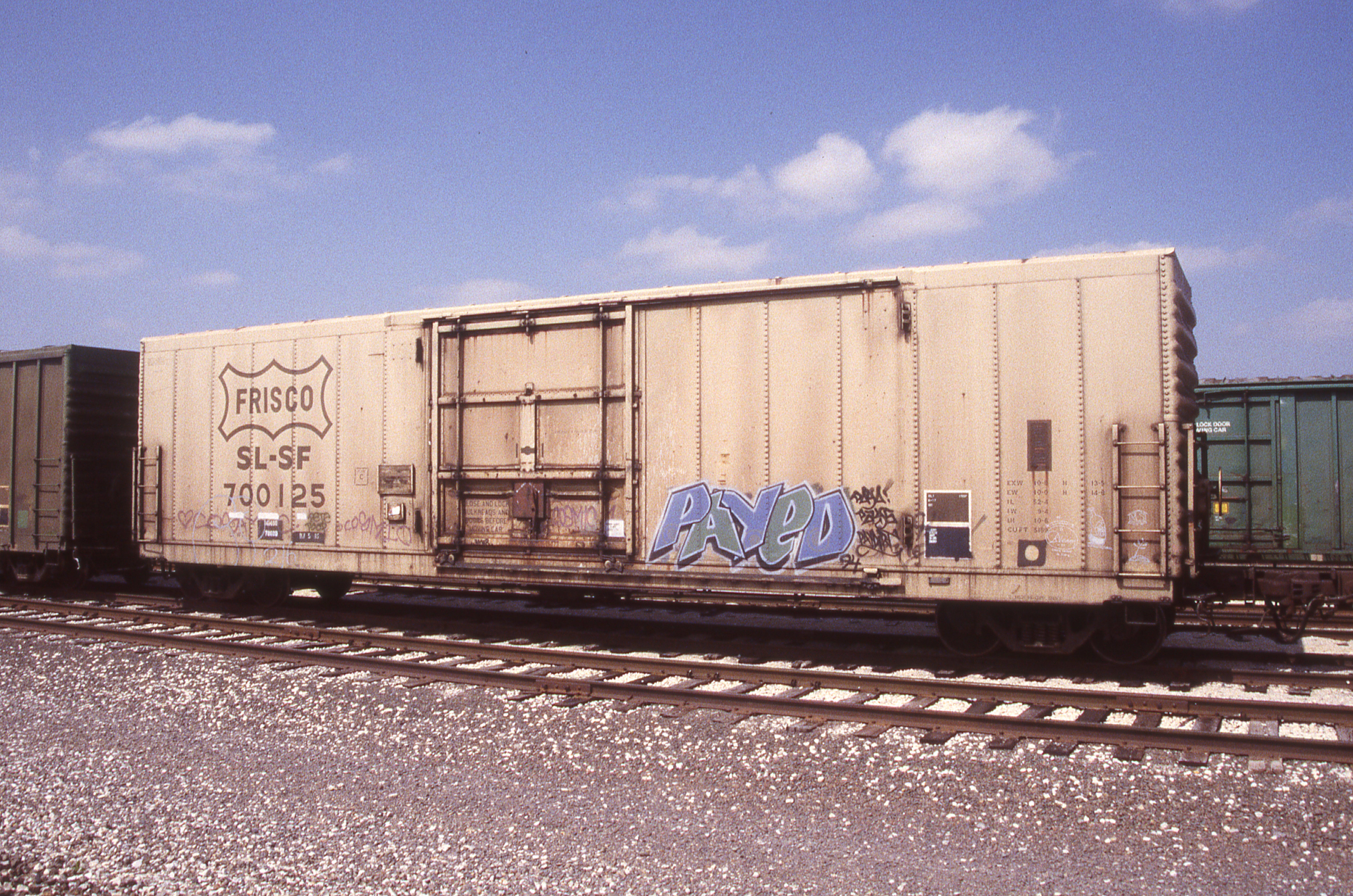 Boxcar 700125 at Topeka, Kansas on April 5, 1998 (R.R. Taylor)