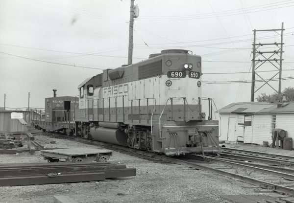 GP38-2 690 and Transfer Caboose 1340 at Kansas City, Missouri on July 3, 1976