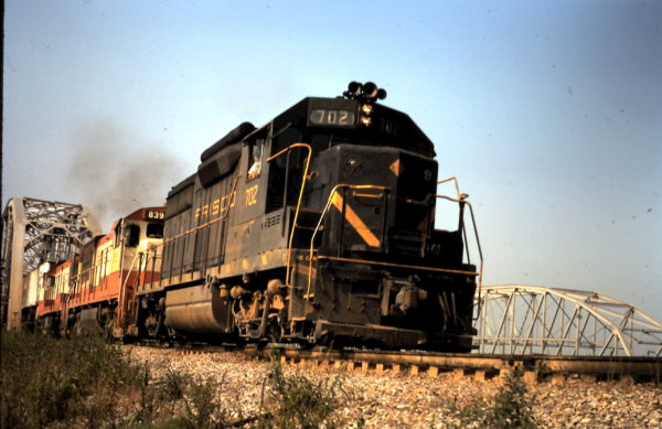 GP35 702 and U30B 839 at Staley, OK, Red River bridge (date unknown)