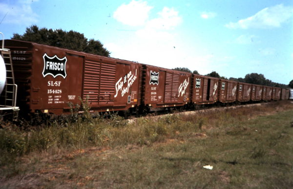 Boxcars 154428 and 154338 (date and location unknown)