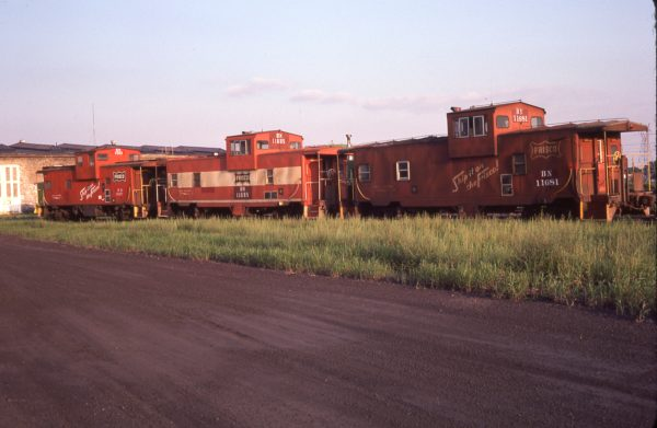 Cabooses 11563 (Frisco 1235), 11695 (Frisco 1721), and 11681 (Frisco 1706) at St. Paul, Minnesota on August 18, 1981