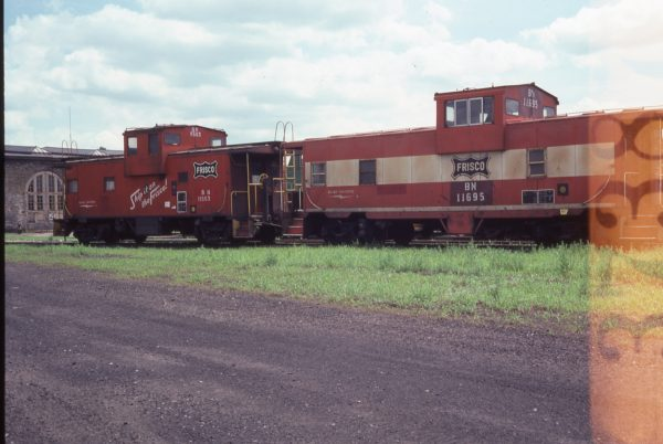 Cabooses 11563 (Frisco 1235) and 11695 (Frisco 1721) at St. Paul, Minnesota on July 18, 1981