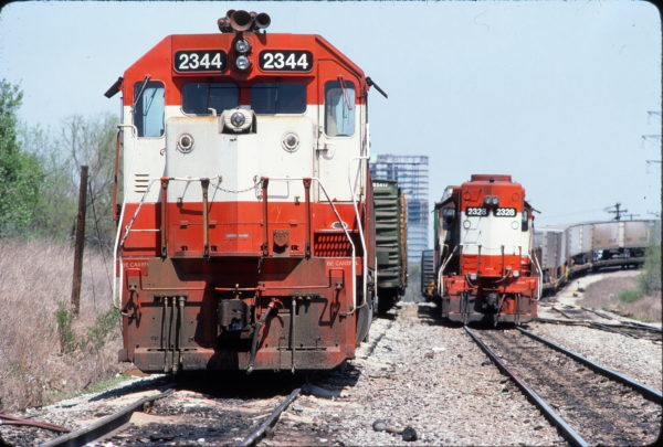 GP38-2s 2344 (Frisco 673) and 2328 (Frisco 473) at Irving, Texas on April 6, 1983 (Bill Bryant)