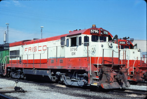 U30B 5796 (Frisco 859) and GP38AC 2135 (Frisco 659) at Springfield, Missouri in March 1981