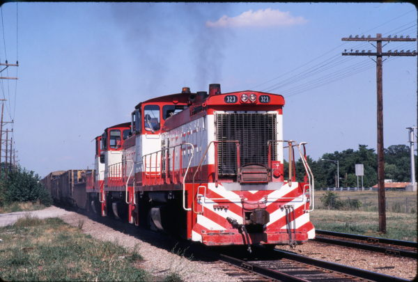 SW1500 323 at Webster Groves, Missouri on August 3, 1980 (Michael Wise)