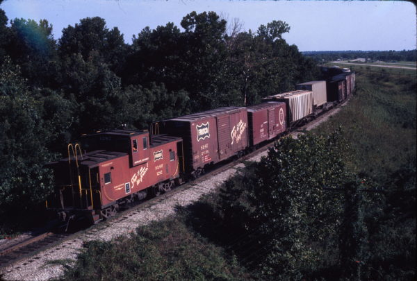 Caboose 1282 and Boxcar 28175 (location unknown) in October 1974