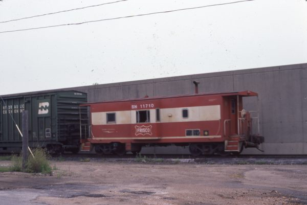 Caboose 11710 (Frisco 1735) (location unknown) in July 1982 (Jim Hoops)