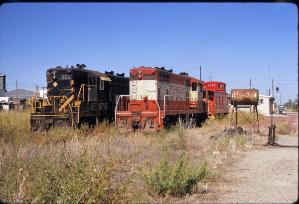GP7s 500, 502 and Caboose 1147 at Clinton, Oklahoma on September 30, 1972