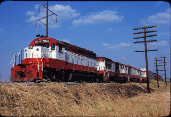 SD40-2 954 and U30B 834 lead Train 537 at Oklahoma City, Oklahoma on August 9, 1980