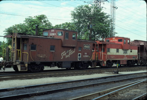 Cabooses 11593 (Frisco 1265) and 11570 (Frisco 1242) at St. Louis, Missouri in June 1981 (Ken McElreath)