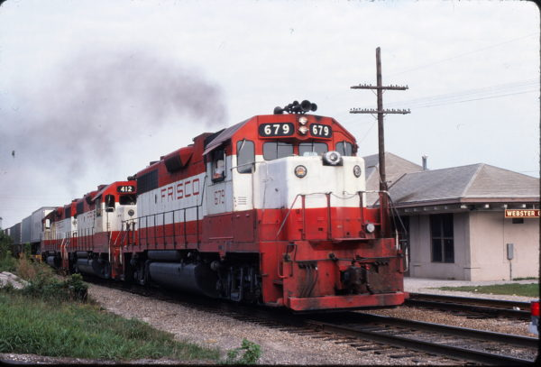 GP38-2s 679 and 412 at Webster Groves, Missouri on August 25, 1979 (Steve Gartner)