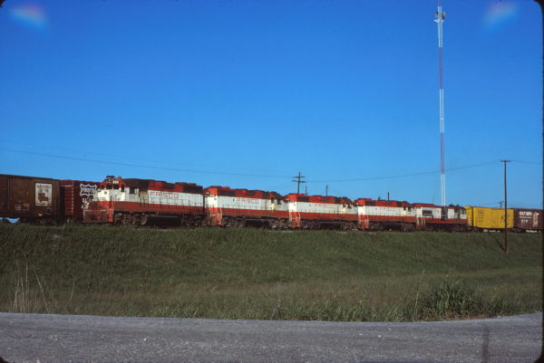 GP38AC 650, GP38-2s 674, 433, 451, U30B 849 and Boxcar 8680 at Memphis, Tennessee on October 10, 1977 (Alton Lanier)