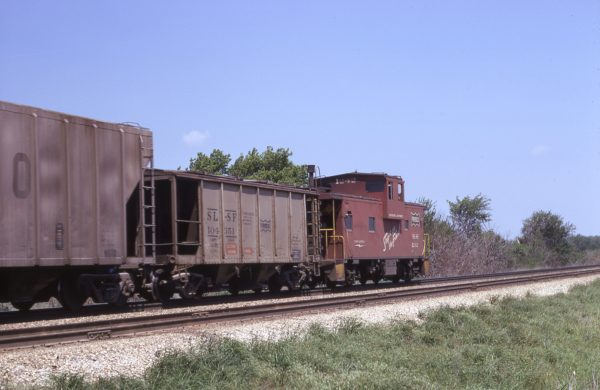 Hopper 104351 and Caboose 1242 (location unknown) in May 1970
