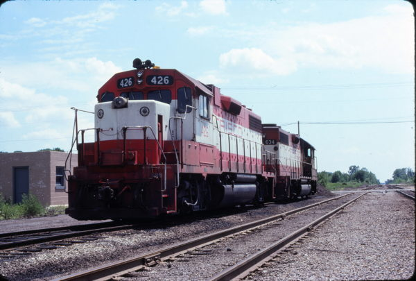 GP38-2 426 and GP38AC 634 at Chaffee, Missouri in July 1979 (Ken McElreath)