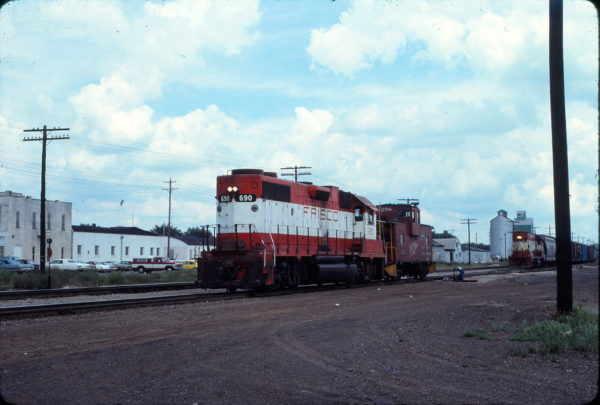 GP38-2 690, Caboose 1258 and GP15-1 1011 at Monett, Mo. in September 1979