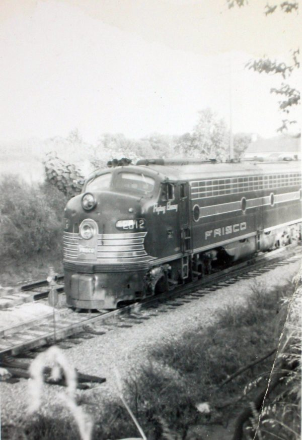 E8A 2012 (Flying Ebony) on Train #106 at Holly Springs, Mississippi in 1955
