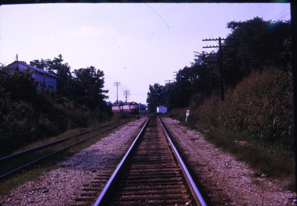 GP38AC 655 at Holly Springs, Mississippi - Southbound Frisco about to pass through the interlocker in July 1974