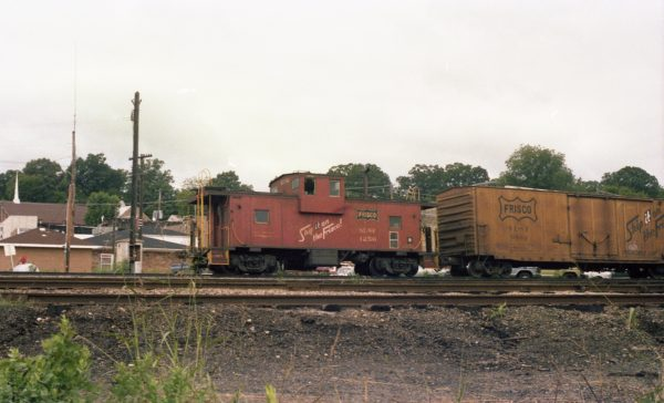 Caboose 1256 and Boxcar 6892 at Thayer, Missouri on July 28, 1979 (R.R. Taylor)